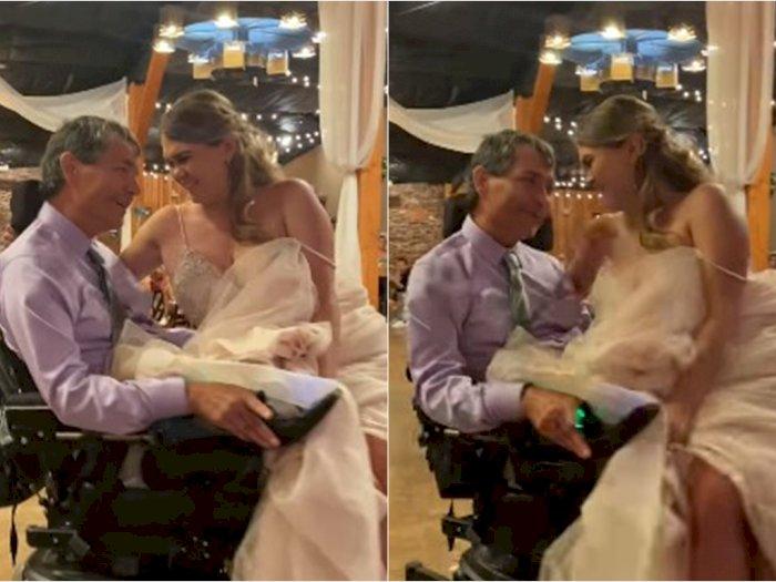Momen Haru Pengantin Wanita Berdansa Dipangku Ayahnya di Kursi Roda